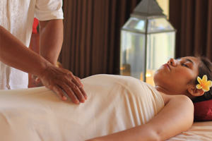 Woman gets energy transfer during reiki process